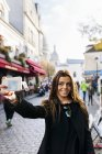 France, Paris, young woman taking a selfie in Montmartre — Stock Photo