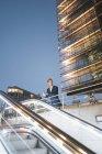 Germany, Berlin, Potsdamer Platz, waiting businessman in the evening — Stock Photo