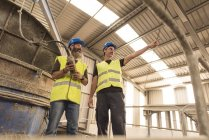 Two workers at giant concrete mixer — Stock Photo