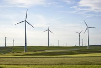 Germany, Rhineland-Palatinate, Woerrstadt, wind farm and fields — Stock Photo