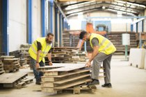 Male workers in warehouse working together — Stock Photo