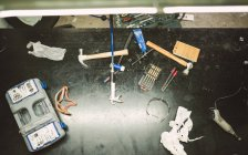 Tools on work bench in repair workshop, close up — Stock Photo