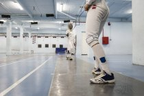 Female fencers during a fencing match — Stock Photo