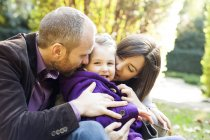 Parents with her little daughter in the park — Stock Photo