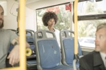People riding in city bus — Stock Photo