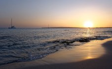 Spain, Formentera, sunset at Playa de Migjorn — стокове фото