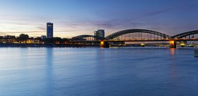 Germany, Cologne, view to KoelnTriangle and Hohenzollern Bridge at evening twilight — Stock Photo