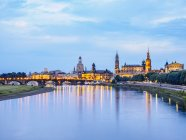 Germany, Saxony, Dresden, historic old town with Elbe River in the foreground in the evening — Stock Photo