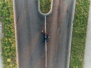 Run over businessman lying on road — Stock Photo