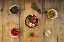 Buddha bowl of black amaranth, avocado, Purple Haze, roasted chickpeas, tomatoes and ajvar — Stock Photo