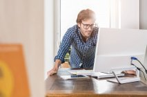 Young man working at home office — Stock Photo