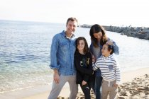 Portrait of happy family together on the beach — Stock Photo
