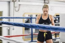 Female caucasian boxer in boxing ring — Stock Photo