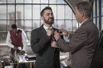 Best man helping groom getting ready before the wedding — Stock Photo