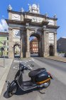 Austria, Tyrol, Innsbruck, Triumphpforte, view of scooter against gate — Stock Photo