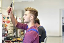 Electrician students looking at device — Stock Photo