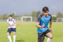 Two soccer players exercising on sports field — Stock Photo