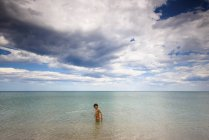 Cute little boy wading in the sea — Stock Photo