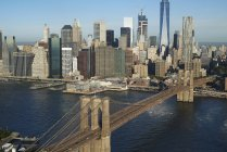 USA, New York, Aerial view of the Brooklyn Bridge and cityscape in sunlight — Stock Photo