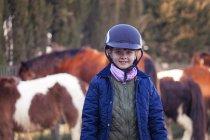 Portrait of smiling girl on horse farm — Stock Photo