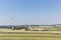 Austria, Gaenserndorf, wind park on green field — Stock Photo