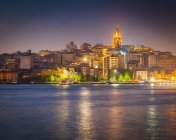Turkey, Istanbul, view to lighted Galata Tower over Golden Horn illuminated at night — Stock Photo