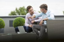 Business people having a meeting on rooftop terrace — Stock Photo