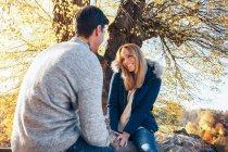 Couple enjoying autumn in forest — Stock Photo