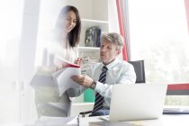 Businessman and woman working together in office — Stock Photo