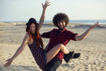 Portrait of young couple having fun on the beach — Stock Photo