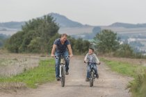 Little boy on bicycle tour with his father — Stock Photo