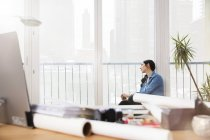 Woman in office looking out of window — Stock Photo