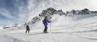 France, Les Contamines, ski mountaineering in snow covered mountains — Stock Photo