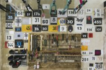 Numbers and tools hanging at the wall in a workshop — Stock Photo