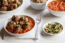 Plate of aubergine oat balls with tomato sauce — Stock Photo