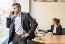 Businessman on the phone in office — Stock Photo