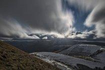 Italy, Umbria, Monti Sibillini National Park, Clouds on plateau Piano Grande of Castelluccio di Norcia — Stock Photo