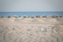 Germany, Warnemuende, beach with hooded beach chairs — Stock Photo