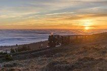 Germany, Saxony-Anhalt, Harz National Park, Brocken, Harz Narrow Gauge Railway in the evening in winter — Stock Photo