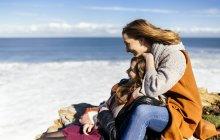 Two young women having fun near the sea — Stock Photo