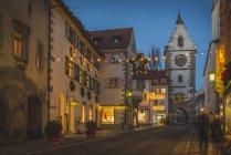 Germany, Ueberlingen, Christmas illumination in Franziskanerstrasse with Franziskanertor — Stock Photo