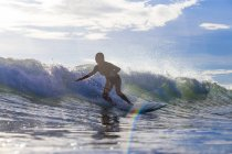 Indonesia, Lombok, Surfer on a wave — Stock Photo
