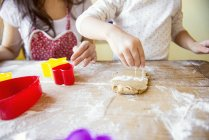 Mother and little daughter baking together — Stock Photo