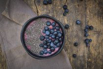 Blueberry smoothie with chia seeds in bowl, fresh blueberries — Stock Photo