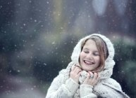 Portrait of happy young woman wearing knitwear in winter — Stock Photo
