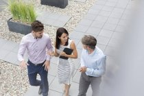 Business people meeting on rooftop terrace — Stock Photo
