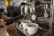 Portafilter machine, two cups of cappuccino — Stock Photo