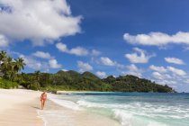 Seychelles, Indian Ocean, Mahe Island, Beach Anse Intendance, female tourist on beach — Stock Photo