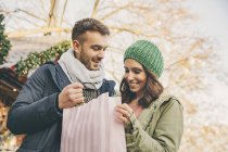 Couple on Christmas Market with gift bag — Stock Photo