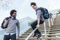 Man sliding on stair-rail — Stock Photo